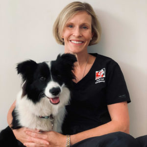 Perth Vet Emergency veterinarian Dr Taleta Hompas with a dog